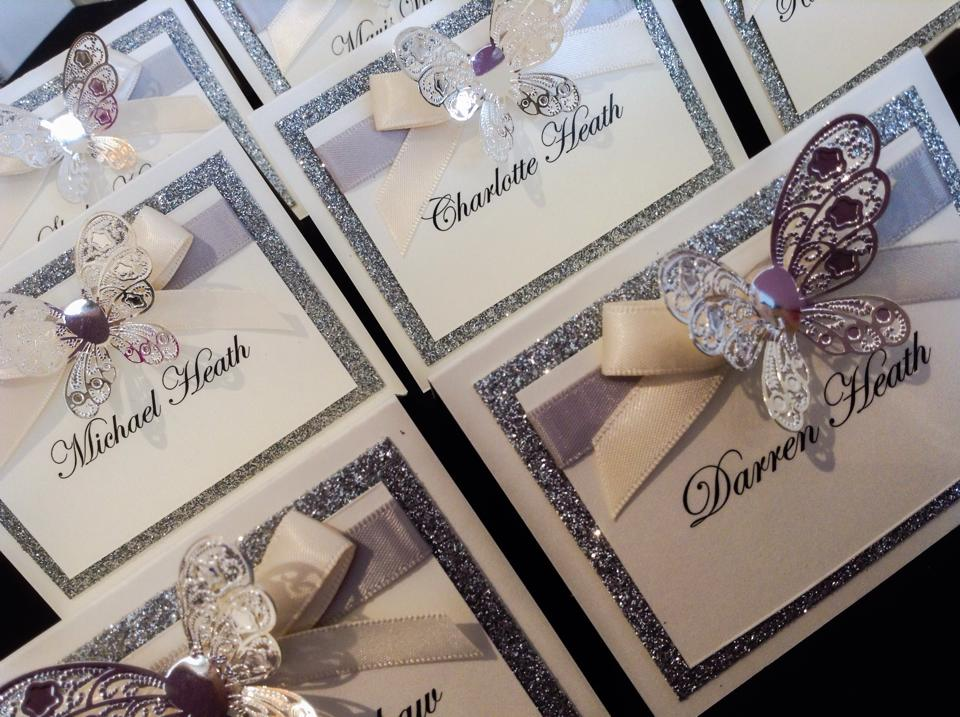 Wedding stationery with sparkling silver satin and butterfly embellishment