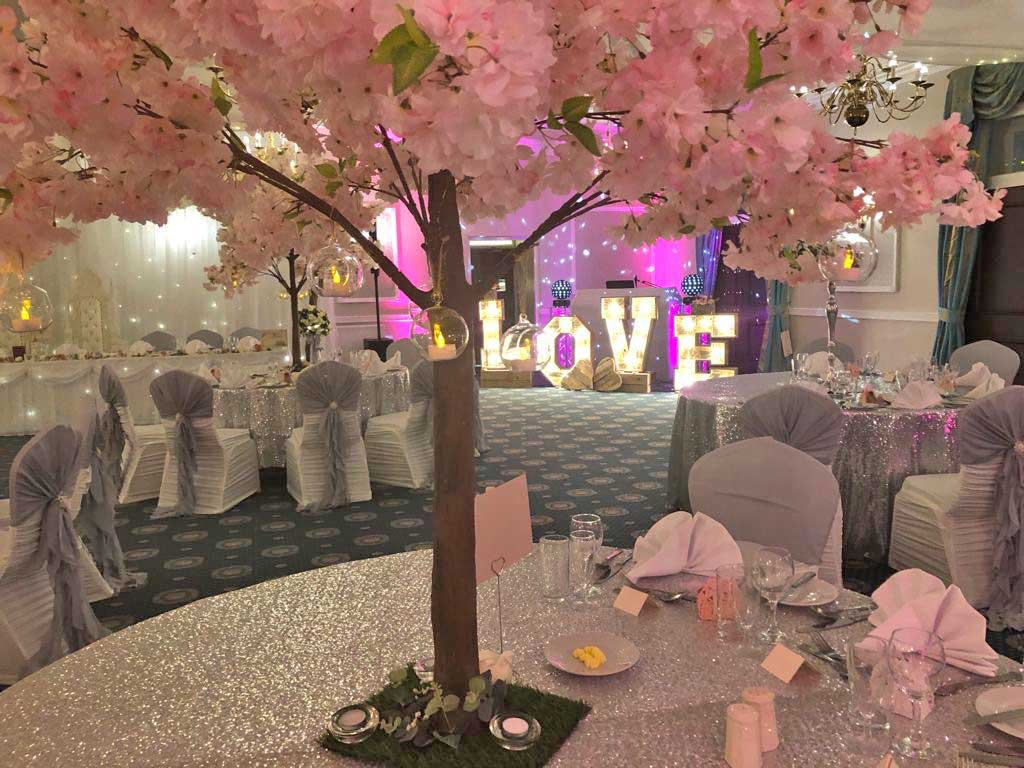 Beautiful blossom tree, sparkling silver table cloths & large romantic LOVE letters - venue styling by Sophisticated Events at Shaw Hill Golf Club Panina Suite