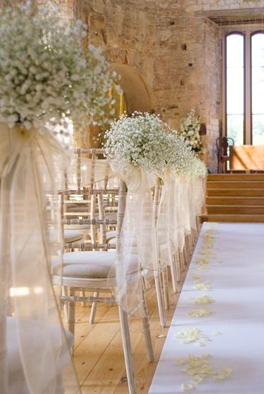 Chivalry chairs decorated with gypsophila & white organza sash - Sophisticated Events
