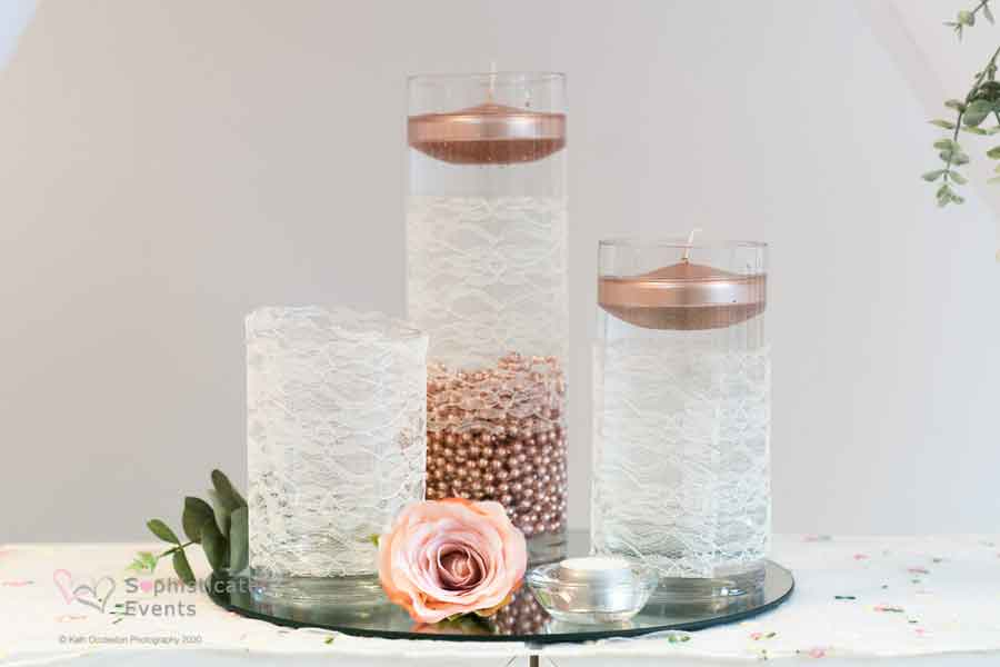 3 cylinder vase centrepiece display with rose gold beads & rose gold floating candles - Sophisticated Events wedding styling