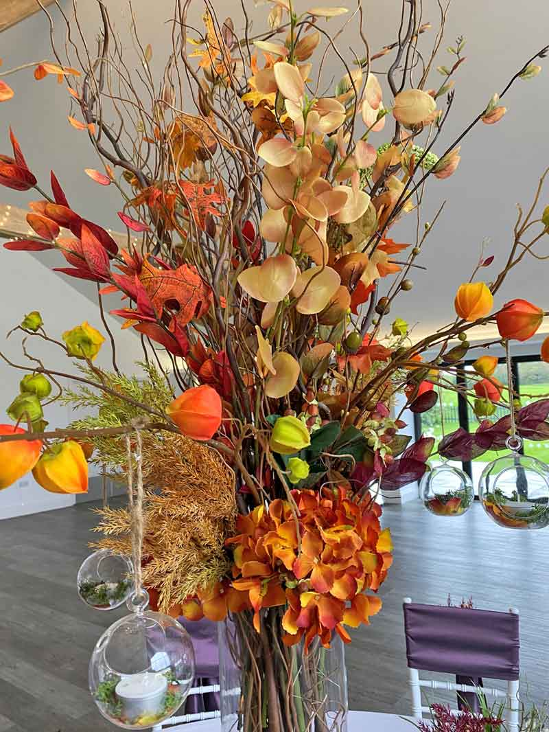 Rustic, autumnal table centrepiece display by Sophisticated Events