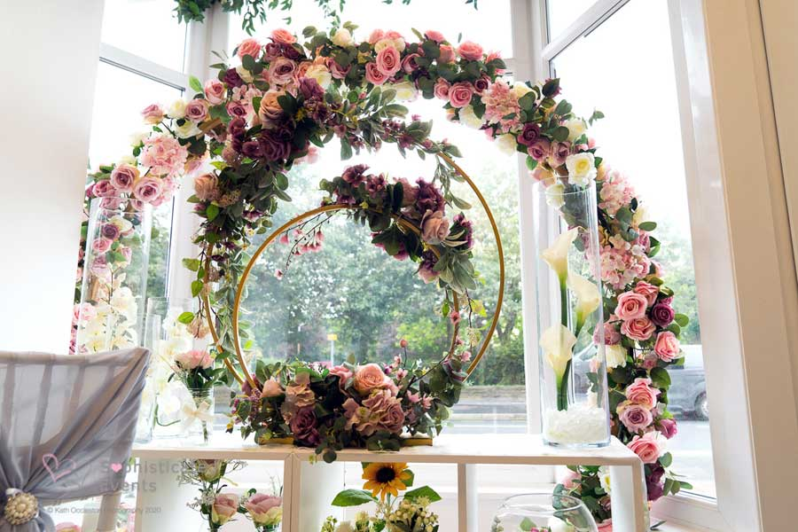 Choose the floral double hoop or moongate archway centrepiece - Sophisticated Events wedding styling