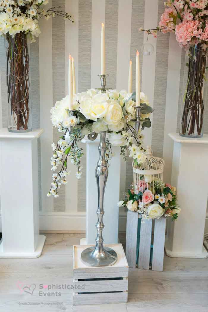 Silver candelabra centrepiece with floral display -Sophisticated Events