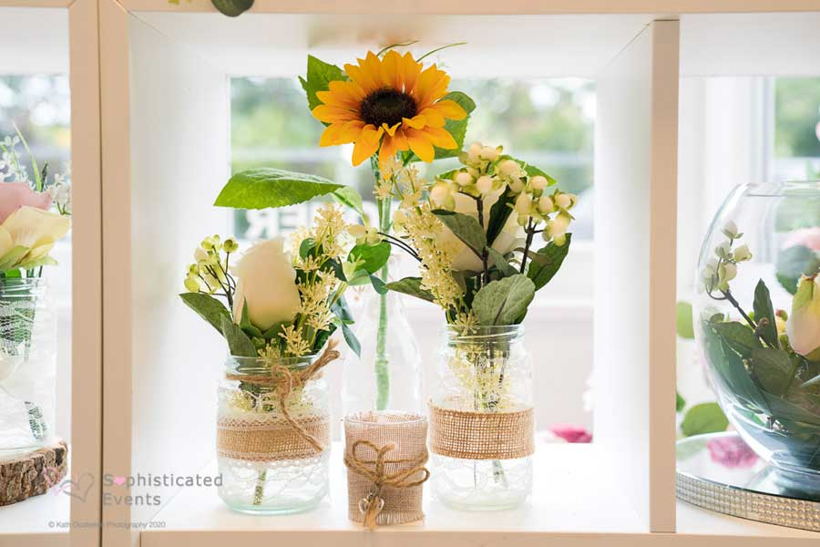 Centrepieces sunflower in glass jar display - Sophisticated Events