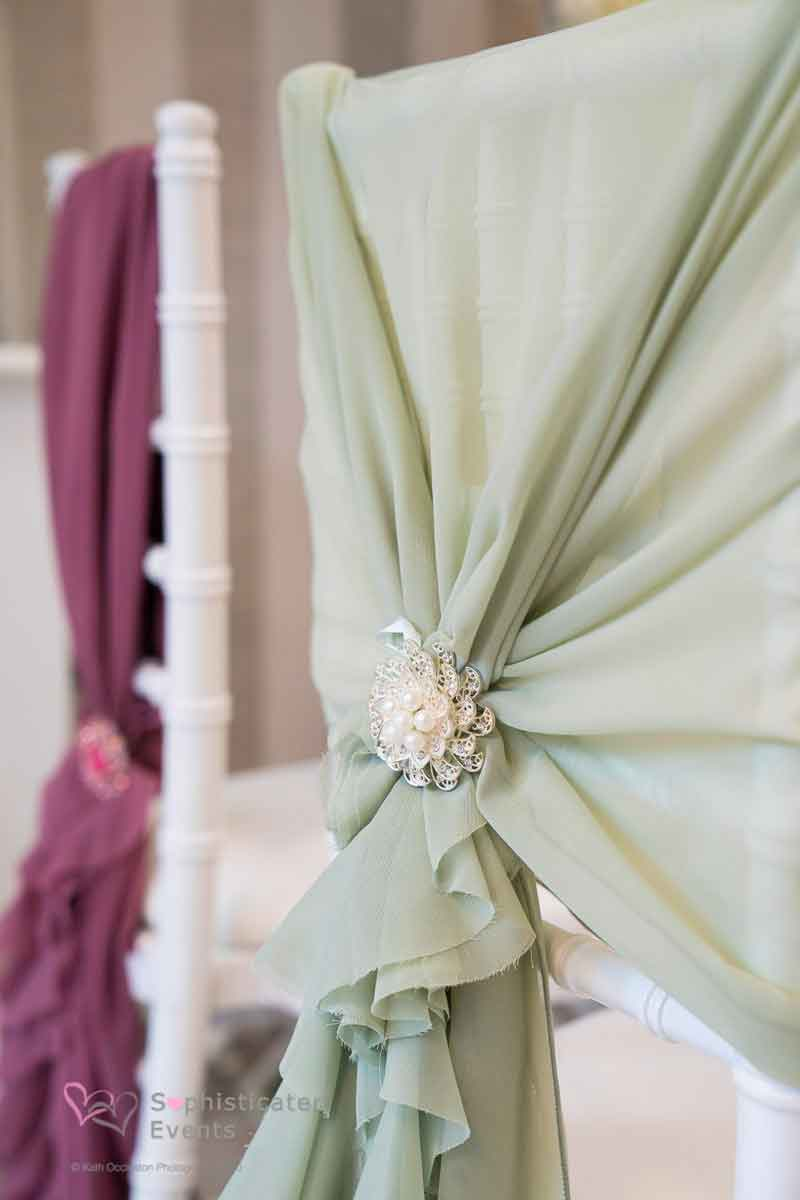 Gorgeous sage green ruffled hoods & mauve purple ruffled vertical drops chair styling - Sophisticated Events