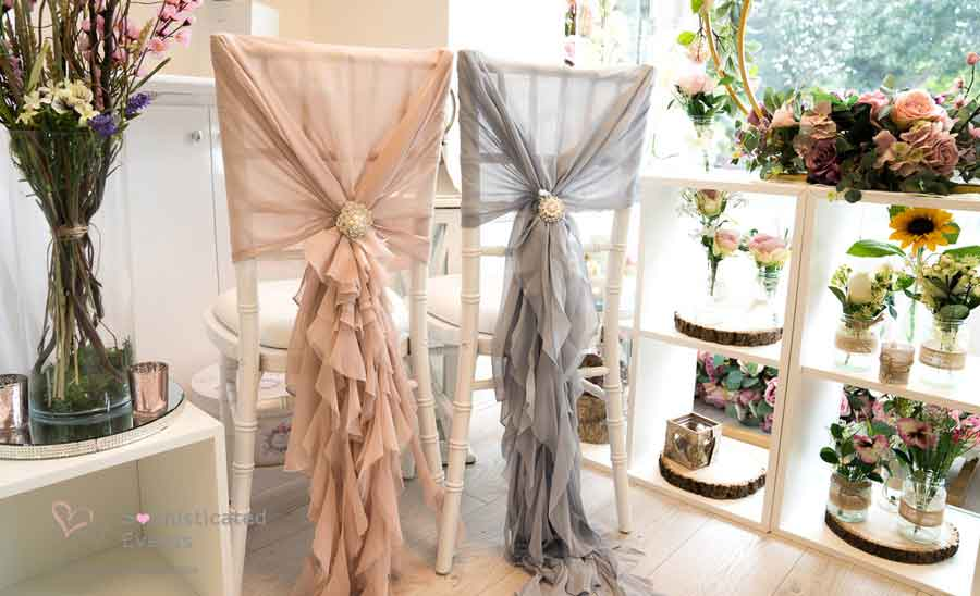 Nude pink & silver grey ruffled chair hoods - venue dressing by Sophisticated Events