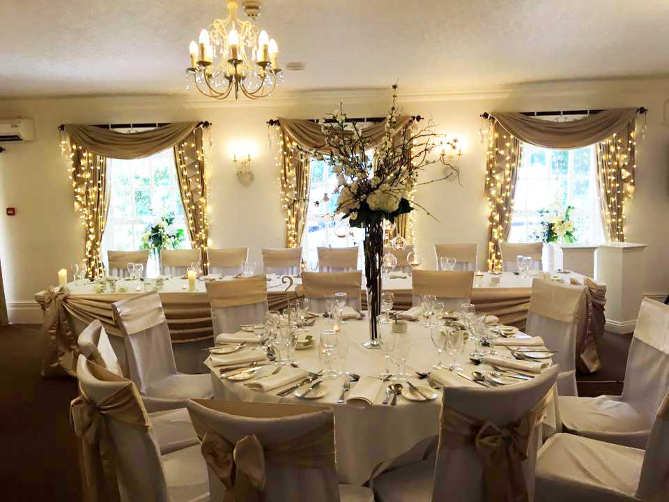 Champagne silk top table drape & matching sash bow chair covers by Sophisticated Events