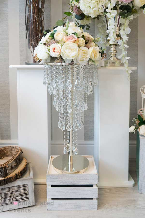 Small chandelier wedding styling centrepiece by Sophisticated Events