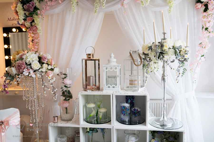 Various centrepieces on display in our Weddings by Alexander & Co wedding boutique - chandelliers, lanterns, cylinder vases, candelabras