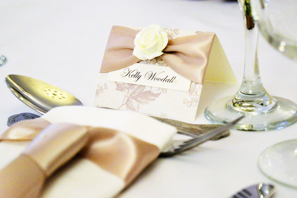 Decorative floral name place card with cappuccino satin bow & ivory rose