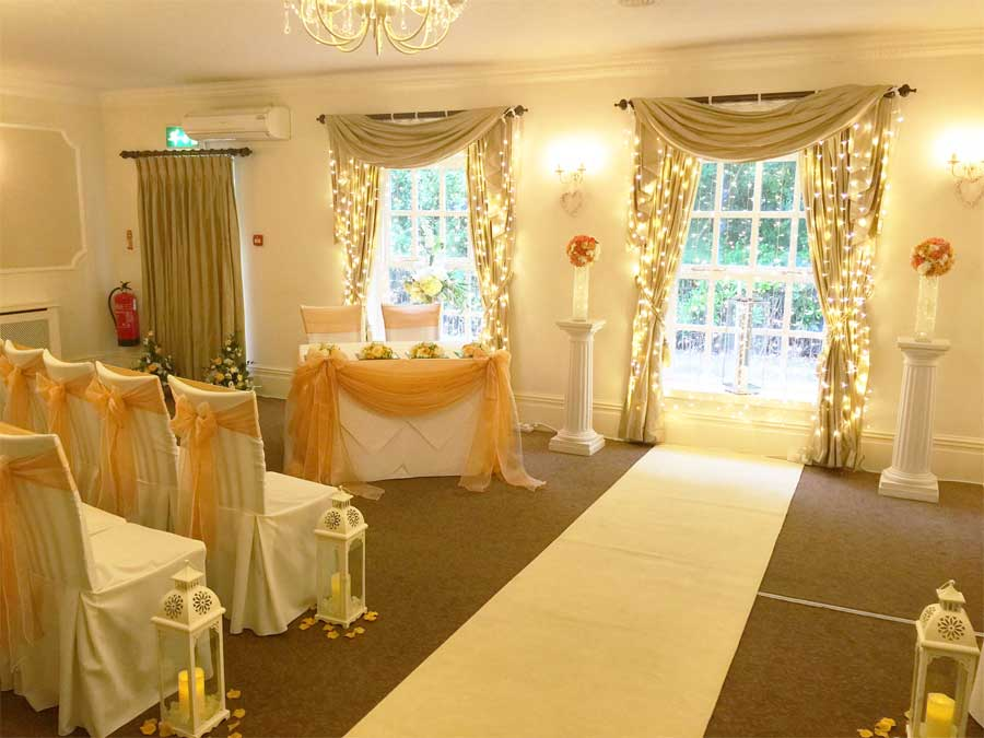 Dressed wedding ceremony table & co-ordinating chair sash bows - Sophisticated Events at Singleton Lodge