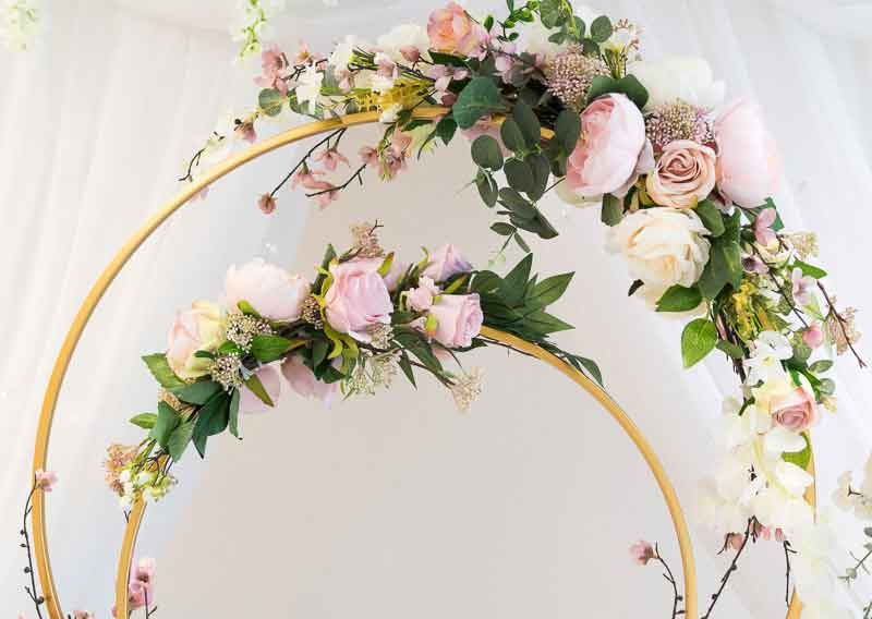 Beautiful double hoop table centrepiece adorned with pink & white roses