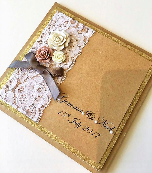 Decorative floral overlay on ivory card with a satin bow & ivory rose