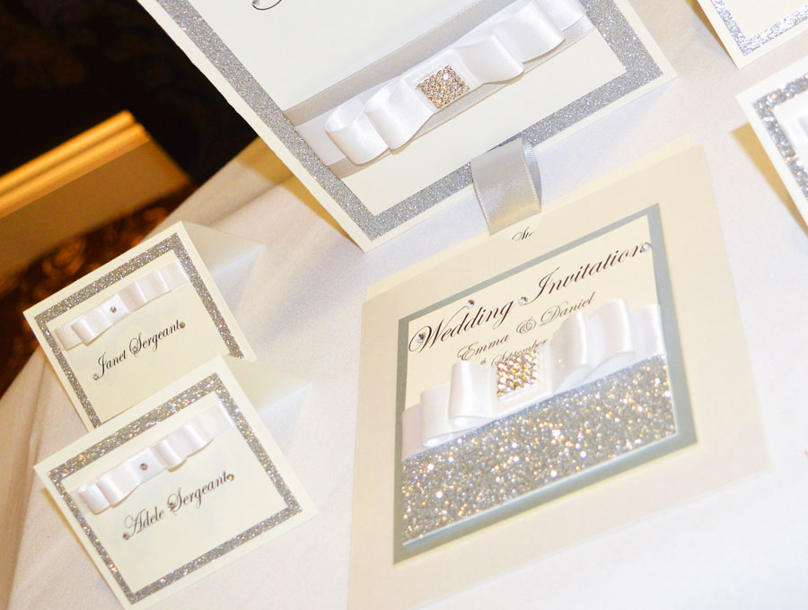 Silver sparkle & white satin ribbon wedding invitation & name place cards