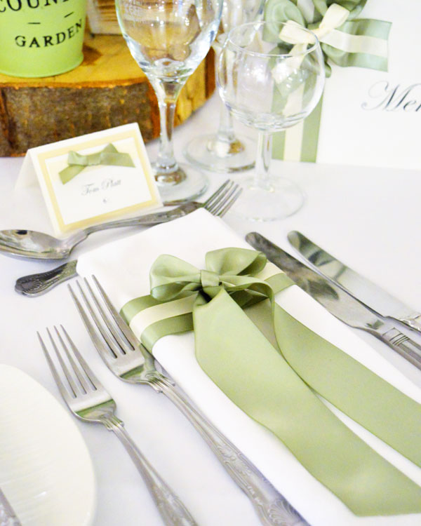 Sage green satin bow napkin dressing & name place card