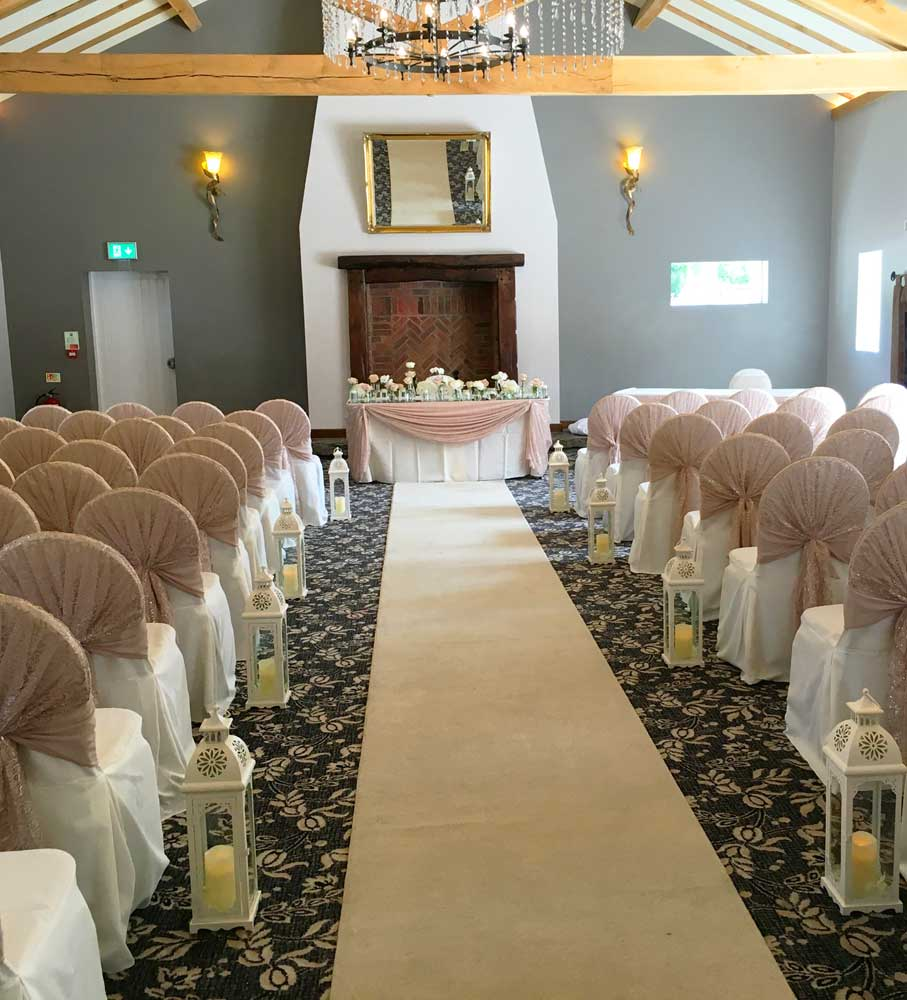 Nude sequin hoods on white cotton chair covers