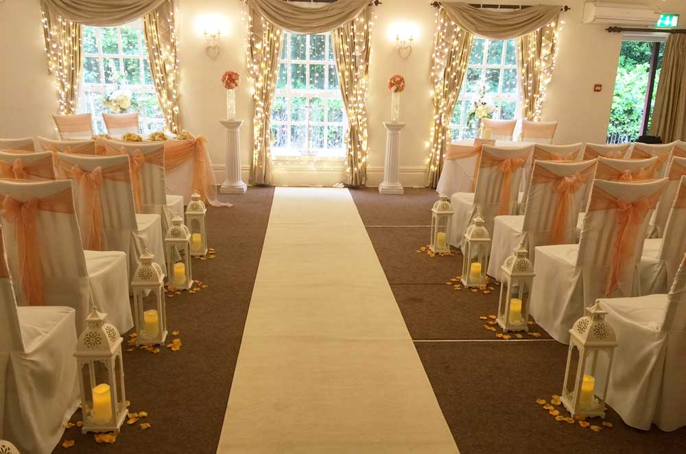 Peach organza sash bow wedding ceremony dressing by Sophisticated Events at Singleton Lodge