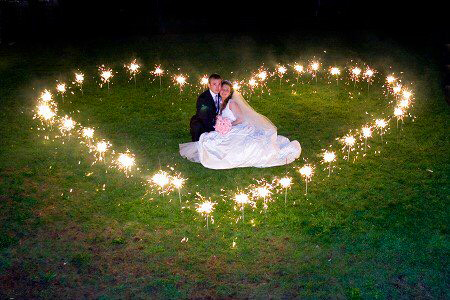 Bride & Groom surrounded by romantic love heart sparklers