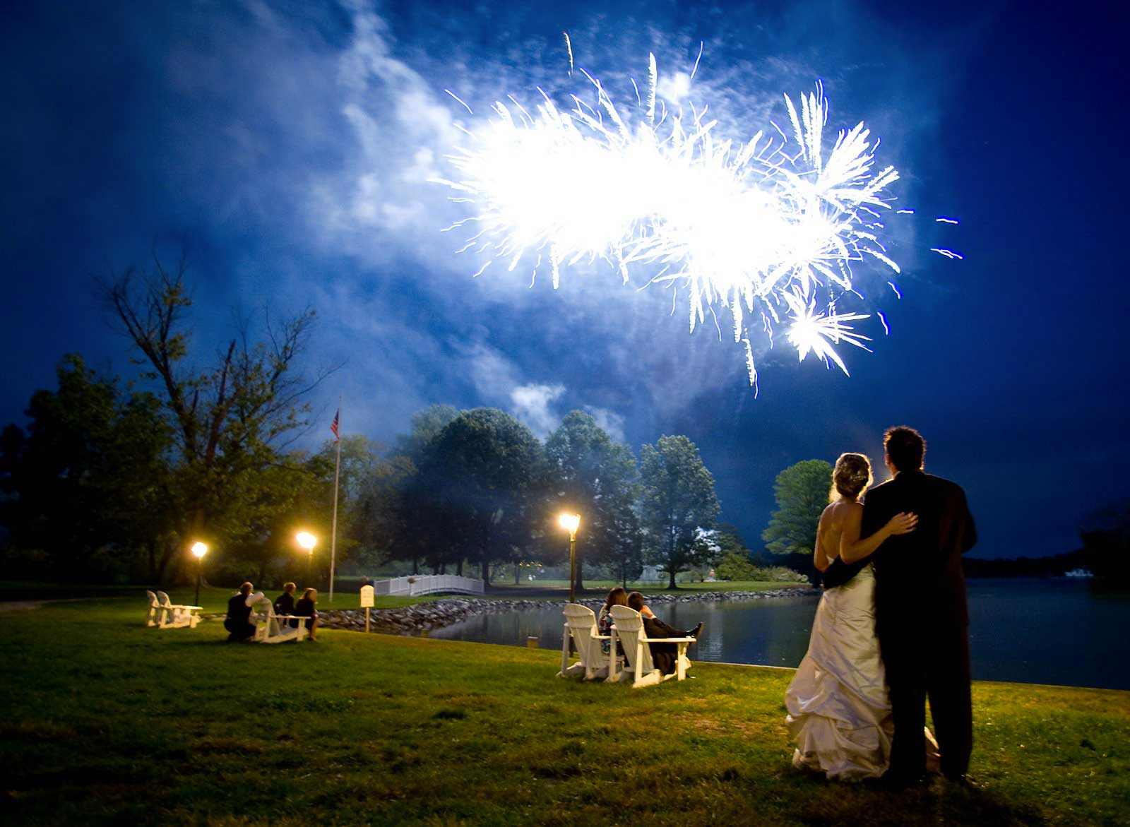 Bride & Groom watching their spectacular firework display over the lake