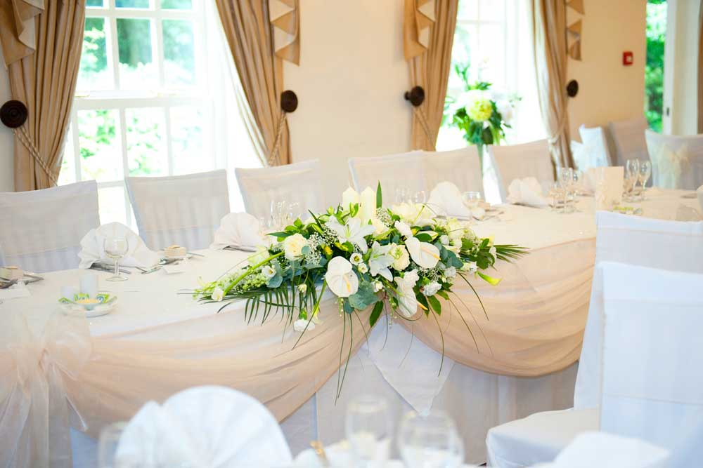 Stunning top table swag, chair covers & sash bow wedding styling by Sophisticated Events at Singleton Lodge