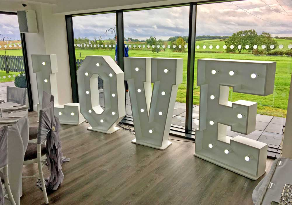 Free standing white LOVE letters with ambient LED lights by Weddings by Alexander & Co