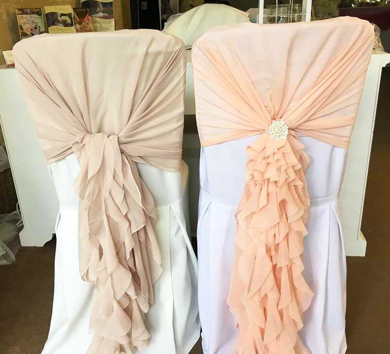 Dusky pink & baby pink ruffled hoods available at Sophisticated Events