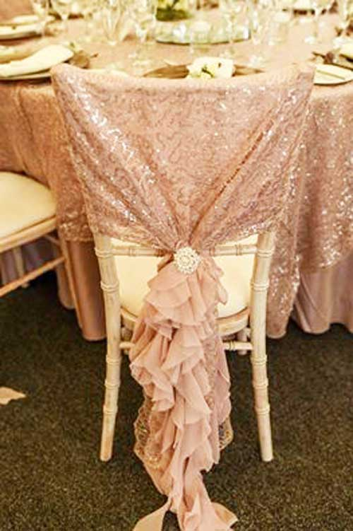 Blush pink frilled hood with sequinned top & sparkly brooch