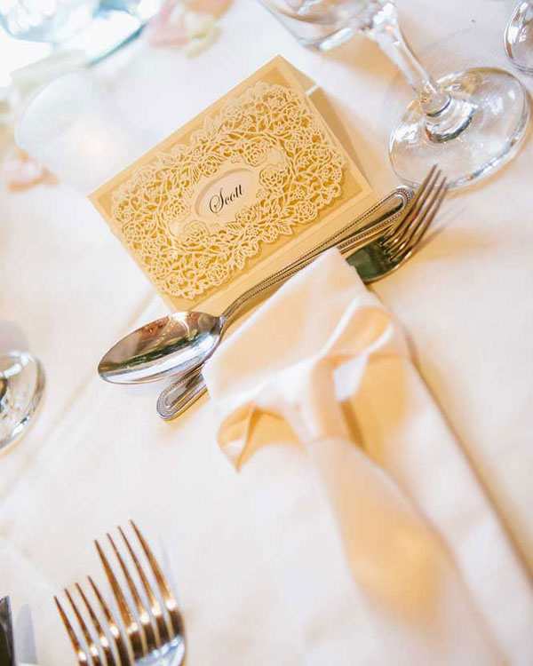 Champagne laser cut name place card & matching napkin dressing