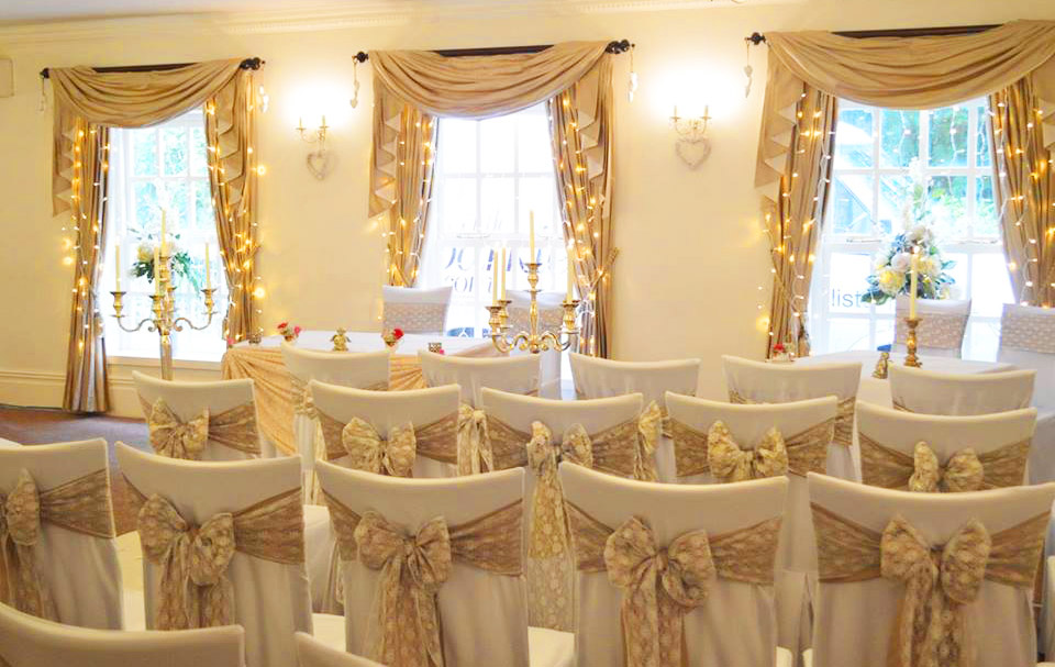 Hessian & lace sash bows over white chair covers by Sophisticated Events at Singleton Lodge