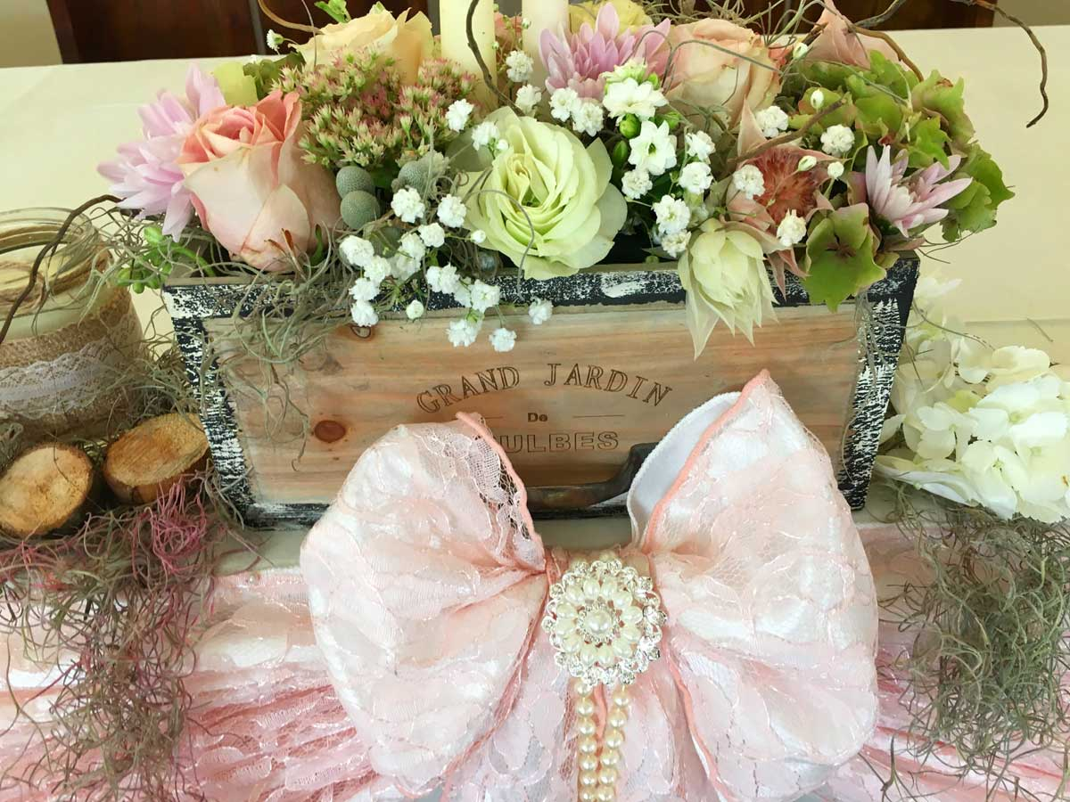 Top table decoration - flower planter & pink & white lace sash bow