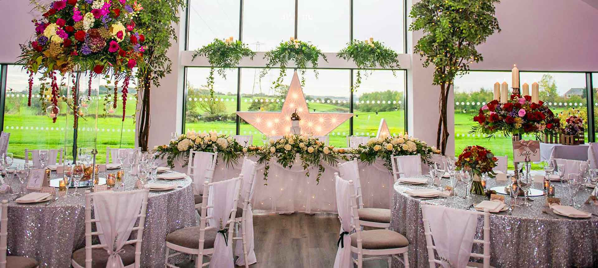 Sparkly silver wedding theme with white vertical drop chair covers - Weddings by Alexander & Co